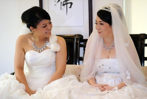 "thedailywhat:  Same-Sex Buddhist Nuptials of the Day: Their union may not be legal, but Yu Ya-ting and Huang Mei-yu on Saturday becameTaiwan's first lesbian couple to be married in a Buddhist ceremony. Huang said the couple hoped that a wedding blessed by a Buddhist master would encourage more Taiwanese, 80 percent of whom are Buddhist, to support same-sex marriage. ""I remember when I told my parents that we would get married, their first question was, 'Is this legal?'"" Huang said. ""I could only say to them that it would soon, but I didn't know when would be considered soon. So we hope it will become legal."" [buzzfeed]"