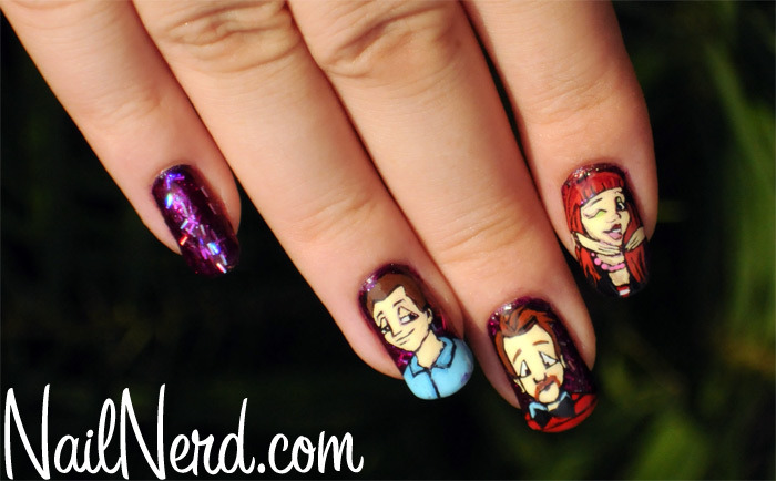 nailnerd-com:  Nail art based on the band Paramore with a purple glitter base