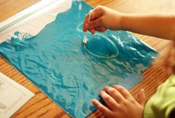 classroomcollective:  Paint-In-A-Bag. A fun, clean way to play with paint and make letters.