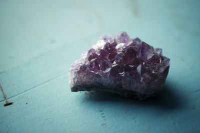 christowitch:  Amethyst is purple quartz, and is a meditative and calming stone. It works in the emotional, spiritual, and physical planes to provide calm, balance, patience, and peace. Amethyst is also beneficial when dealing with legal problems and money issues, which can lead to prosperity and abundance. Emotionally, amethyst can help heal personal losses and grief. Amethyst has a gently sedative energy that promotes peacefulness, happiness, and contentment. It also brings emotional stability and inner strength, and can enhance flexibility and cooperation. Amethyst can help get rid of addictions (alcohol, drugs, smoking, etc.) and compulsive behaviors of all kinds. In the psychic and spiritual realms, amethyst is an excellent all-purpose stone that can increase spirituality and enhance intuition and psychic powers of all kinds. It does this by making a clear connection between the earth plane and other planes and worlds. Amethyst is also excellent for meditation and lucid dreaming. It is known to open one's channels to telepathy, past life regression, clairaudience, clairvoyance, and communication with angels. Amethyst also protects against psychic attacks, especially during spiritual work, and protects one from thieves, and protects travelers. Physically amethyst is said by spiritual healers and mystical lore to heal the withdrawal symptoms of any sort of addiction, help with headaches, insomnia, arthritis, diabetes, pain relief, circulatory system issues, endocrine system problems, chronic fatigue, fibromyalgia, immune system deficiencies,asthma, phobias, pregnancy and preventing miscarriage, menopause, PMS, and general healing. It is also said that Amethyst will protect from psychic vampires and should be left around windows and doors of a house to protect against their psychic attacks. Amethyst is associated with the third eye and crown chakras primarily, but can also open the heart chakra.