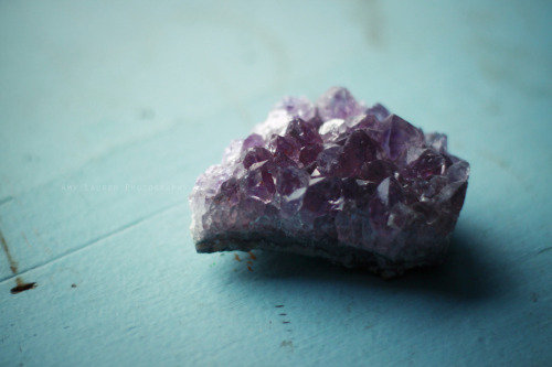 christowitch:  Amethyst is purple quartz, and is a meditative and calming stone. It works in the emotional, spiritual, and physical planes to provide calm, balance, patience, and peace. Amethyst is also beneficial when dealing with legal problems and money issues, which can lead to prosperity and abundance. Emotionally, amethyst can help heal personal losses and grief. Amethyst has a gently sedative energy that promotes peacefulness, happiness, and contentment. It also brings emotional stability and inner strength, and can enhance flexibility and cooperation. Amethyst can help get rid of addictions (alcohol, drugs, smoking, etc.) and compulsive behaviors of all kinds. In the psychic and spiritual realms, amethyst is an excellent all-purpose stone that can increase spirituality and enhance intuition and psychic powers of all kinds. It does this by making a clear connection between the earth plane and other planes and worlds. Amethyst is also excellent for meditation and lucid dreaming. It is known to open one's channels to telepathy, past life regression, clairaudience, clairvoyance, and communication with angels. Amethyst also protects against psychic attacks, especially during spiritual work, and protects one from thieves, and protects travelers. Physically amethyst is said by spiritual healers and mystical lore to heal the withdrawal symptoms of any sort of addiction, help with headaches, insomnia, arthritis, diabetes, pain relief, circulatory system issues, endocrine system problems, chronic fatigue, fibromyalgia, immune system deficiencies,asthma, phobias, pregnancy and preventing miscarriage, menopause, PMS, and general healing. It is also said that Amethyst will protect from psychic vampires and should be left around windows and doors of a house to protect against their psychic attacks. Amethyst is associated with the third eye and crown chakras primarily, but can also open the heart chakra. (info from http://www.crystalsandjewelry.com/metaphysical_healing/stoneinfo/amethyst.html)