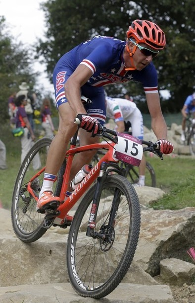 Tod Wells, of The United States, competes in the Mountain Bike Cycling men's race, at the 2012 Summer Olympics, Sunday, Aug. 12, 2012, at Hadleigh Farm, in Essex, England. (via Photo from AP Photo)