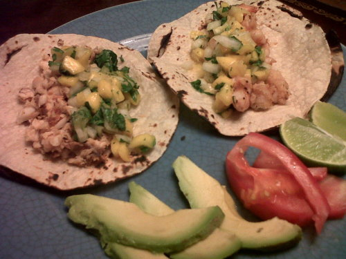 Dinner: Seafood tacos.   Pan seared tilapia (left) & shrimp (right) w/ homemade mango, pineapple & mint salsa.