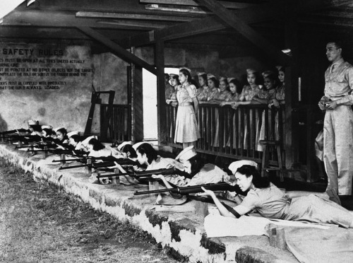 "collective-history:  The first ""Women Guerrilla"" corps has just been formed in the Philippines and Filipino women, trained in their local women's auxiliary service, are seen here hard at work practicing on November 8, 1941, at a rifle range in Manila. (AP Photo)"