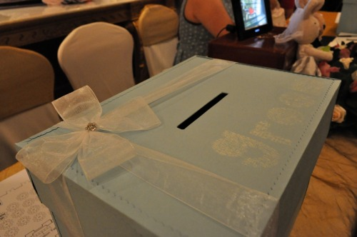"Ang pao box with ribbons and ""groom"" stenciling. Another box with ""bride"" stenciling. [The wedding of Shirong & Terry - 24 June 2012]"