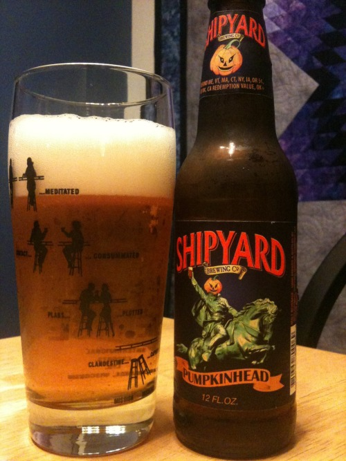 Beer six of 100 Beers in 100 Days = Shipyard's Pumpkinhead. Tracked this down after a recommendation from a friend but more importantly, know this; I love pumpkin. LOVE it. It is my favorite flavor of anything ever. I would kill a man in a dark back alley to get my hands on a tub of pumpkin cream cheese (my absolute favorite form of pumpkin). So I guess what I'm saying is, this may be the first pumpkin beer but it won't be the last. Tis the season and I will take it upon myself to try as many as possible for the benefit of my readers. All three of you. Yeah, that's it. We'll go with that.  Anyway, this particular pumpkin brew was good, fresh tasting, but a tad bit monotone. I suppose I prefer to taste more of the pie spices that usually accompany pumpkin flavors and while the ginger is fairly evident the cinnamon and nutmeg were lacking. That said, being that it's not an overwhelming beer, this would be an excellent session choice for the fall holidays. I can see buying a case, sitting around a bonfire all night telling scary stories, and eating boatloads ofhalloween candy that I bought the morning after Halloween when it's all gone on clearance. 7/10.