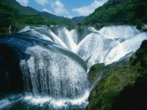 This doesn't even seem real! We'd love to visit Pearl Shoal Waterfall in the western Sichuan Province of China. Has anyone been?