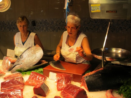 Ladies selling tuna in La Boqueria.