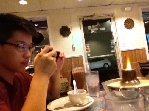My Chinese friend Gary taking a picture of Thai food in Los Angeles, CA How the picture turned out: http://oi49.tinypic.com/wbewrr.jpg