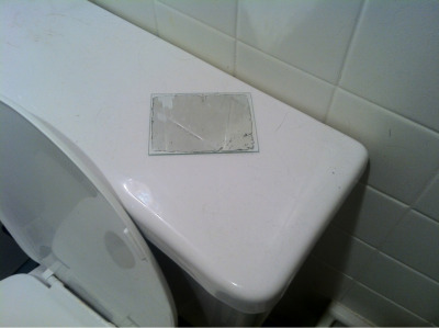 Small mirror found on top of toilet in private residence.