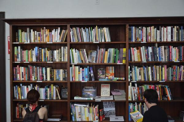 "thepeoplesrecord:  Activists revive shuttered library in East OaklandAugust 14, 2012 Around 7 a.m. Monday, activists took over a vacant building in East Oakland's San Antonio neighborhood, which they said had been left unlocked. After word spread on Facebook, about a dozen volunteers arrived and set to work, stocking it with donated books and clearing out grime, old mattresses, graffiti and other markings of abandonment. A bilingual banner hanging in front of the entrance at 1449 Miller Ave. welcomed passers-by to the ""Victor Martinez People's Library,"" named for the late Latino author. Decades ago, the building housed an official city library, an ornate space with built-in wooden bookshelves and high ceilings decorated with molding. Completed in 1918, it was one of four branches funded with a Carnegie grant. But that branch closed in the 1970s, and since then, the building has sat mostly unused, said Jaime Silva, one of the organizers. Squatters and illegal dumping have turned the property into an eyesore, he said. I think everyone in the community is psyched this will no longer be a dumping ground,"" said Silva, 43. The building is owned by the City of Oakland's Redevelopment Successor Agency within the Office of Neighborhood Investment. In an email Monday, an agency spokesman said the city would issue a dispersal order with a set time to vacate the property; his response didn't include the city's plans for the blighted building, which remains in disrepair. Late Monday morning, people began trickling in. Some checked out books, shared their ideas, or asked how they could help. ""You open Monday through Friday?"" one man asked a volunteer. ""We have no idea,"" the volunteer responded. Goldie Simmons of San Leandro, whose husband is the pastor of the nearby Agnes Memorial Church, said she and her husband had proposed that city officials turn the building into a youth center, but that they were told it needed to be retrofitted. She said she was glad people had taken matters into their own hands. ""There's nothing in this area, really,"" she said. ""There's really no place for kids to come."" Silva and other activists say the goal is for the building to be used for a community purpose, whether it's a library or a community center with a garden. ""All we ask is that you consider keeping it out of the hands of a city which will only seal the fence and doors again, turning the space back into an aggregator of the city's trash and a dark hole in the middle of the community,"" according to the group's news release, aimed at residents of the surrounding neighborhoods. Only thing is, without a permit and city approval, the police consider them squatters—and the building was raided tonight by Oakland PD.  SourcePhoto I suppose the city would rather see an empty building go to waste rather than to have a library & garden open to the community. Libraries, not raids!"