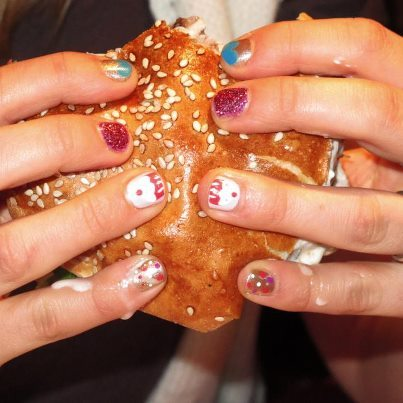 """This manicure is the work of Chelsea Bagan from Trophy Wife Nail Art in Melbourne. The photo's a bit blurry, but there's cupcakes on my ring finger nails! The burger is a Plato's Delight from The Bottom End in Melbourne. A spiced lamb pattie with taramasalata, saganaki, lettuce, tomato, tzatziki and cucumber on a yummy bun. Delicious, bit small though - 7/10."" Thanks Anouk in Melbourne! I look forward to checking out this salon when I'm in Melbourne!"