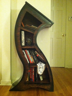 Curved Bookshelf with Melting Clock