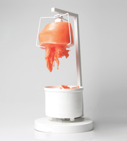 designed-for-life:  revitalizer 2: regenerative wax lamp by merve kahraman The design represents poetic transformation through metamorphosis: the wax embodying the cyclical death and rebirth of the object. After the high voltage bulb inside the lamp melts, the material gradually collects into a retainer and the heat resistance inside the  core allows the wax to create a new mold. once the wax cools down and takes its shape, one can take it out and replace it into the top compartment.  the result is a soft glow created by the dripping substance, creating an ambience that is continually evolving.