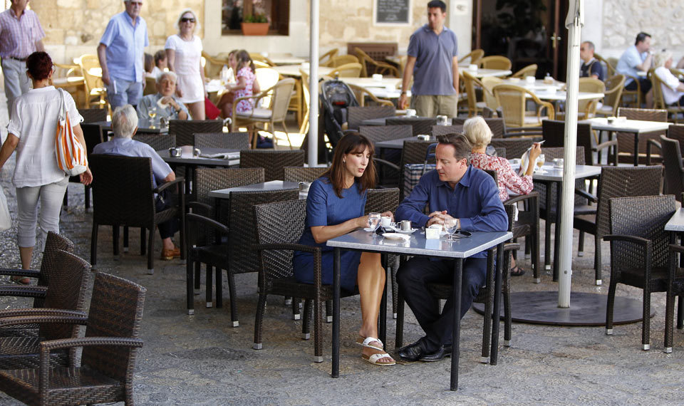 guardian:  guardianpolitics:  The Camerons' holiday style: 50% inspiration, 50% perspiration Photograph: Wpa Pool/Getty Images  Blue on blue - Guardian Fashion analyses the PM's holiday style.  They've cleared the fucking room