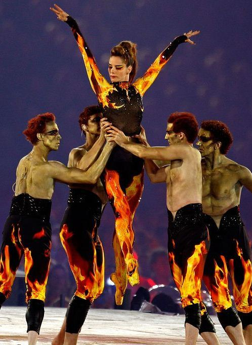 wgsn:  Prima ballerina Darcey Bussell as the Phoenix at the closing ceremony of the London 2012 #Olympics. Accompanied by Royal Ballet Principals Edward Watson, Jonathan Cope, Gary Avis and Nehemiah Kish.