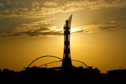 dohanews:  Sunset by Brian Candy and contributed to the Doha News Flickr Group. A perfect silhouette of The Torch and Khalifa Stadium. (By the way: No, Villaggio is not yet open, but yes, it plans to reopen once it has clearance from Civil Defense.) Want to see your photo here? Add it to our Flickr pool or share it via dohanews.co/submit
