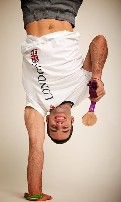 "Danell Leyva just posted this photo to his Facebook page of him ""just hanging out with [his] medal."" The real question is when we get to hang out."