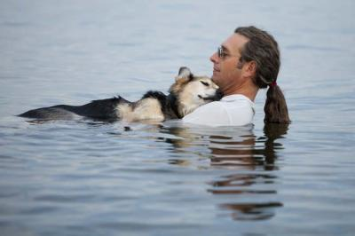 northern0lights:  John Unger and his 19-year-old dog Schoep from Bayfield, Wisconsin have stolen many hearts with one photograph taken by Hannah Hudson. John rescued Schoep when he was just 8 weeks old and the two have been best friends since. Schoep now suffers from severe arthritis in his legs and it hurts so bad that Schoep cannot sleep, but John has figured out a way to ease his best friend's pain. John takes Schoep to the waters of Lake Superior and holds him until he falls asleep, sometimes the two stay in the water for hours. Hannah Hudson snapped a picture of the two and after sharing the picture on Facebook it has been liked over 300,000 times and shared more than 200,000 times. Since the image went viral John has received enough donations to treat Schoeps arthritis.