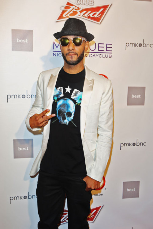 thefashionbomb:  Men's Fashion Flash: Swizz Beatz in Givenchy's Skull and Cards Shirt at the Official Olympic London After Party at Camden's RoundHouse  BRAND CONTROL; never forget these words.  Remember what happened to Moschino, Iceberg, Coogi, Versace, Tommy Hilfiger, Lacoste, Gucci, Burberry, Armani and Cristal in the '90s?  Shit, only a few of the aforementioned ever really recovered from that debacle.  And no one wants to be the posterboy of a racial debate with the hip hop community, that's for sure.  So, keep it simple: avoid making a quick dollar by not selling out to trashbags and keep your integrity, please.