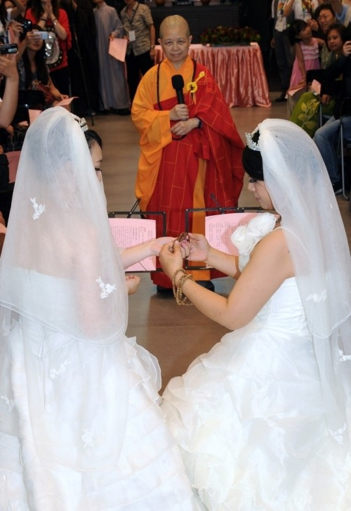 Remember that Taiwanese same-sex Buddhist couple we told you about a few weeks ago? That's them! Check out more photos here. They're so adorable, and what a beautiful wedding! ~Intern Jessie