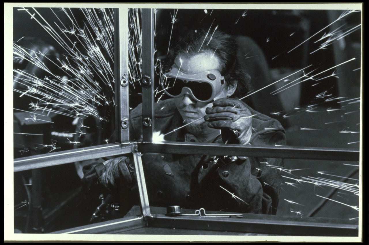 Exploratorium Cookbook cover photograph. Working in machine shop, 1985