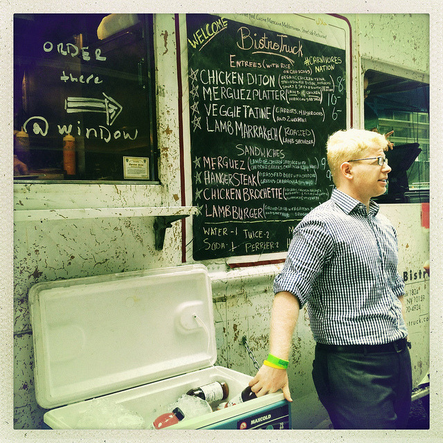 waiting at the bistro truck. midtown. on Flickr.Food trucks have become a sensation. Bursting out from obscurity a couple of years ago, the trucks built a loyal following with hundreds of foodies following food truck vendors on Twitter (or using the awesome tweat.it app) to see where their faves are going to be. You can taste the world and some of the most creative fusion cuisine at an affordable price. The simply named Bistro Truck serves up some delicious Moroccan food and while it may take a little longer to get your food, it's always well worth the wait.
