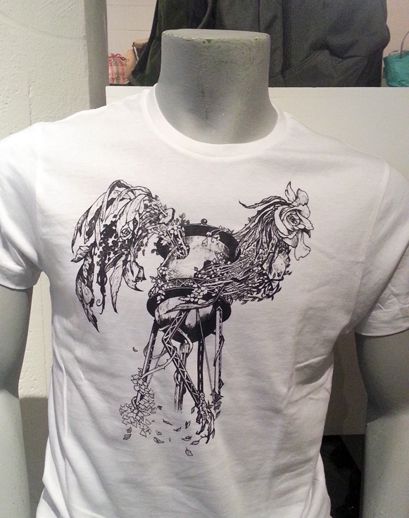 "My friend Simon designed this t-shirt for Brooklyn Industries. Here's what he had to say about it:  ""I lived in Brooklyn for almost nine years and always loved the views of the landscape when the train would go above ground ( like on the F or the N ). I think watertowers are beautiful landmarks and I wanted to capture that image and feeling and combine it with another image of wilderness and power. Roosters are one of my favorite animals and I just saw this image of an old water tower being overrun with foliage in the shape of a rooster, with ivy and leaves and giant flowers. Combining various natural elements to create one cohesive picture excites me as an artist and with this piece I was striving to connect all these themes.""  It's a whopping $36 dollars but you know it's Brooklyn Industries so that's to be expected. I'm just happy he won the competition with a magnificently rad t-shirt."