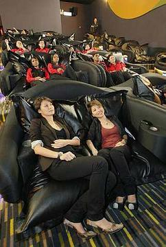 "ricanontherun's post about Dine-In American cinemas reminded me of the luxury cinemas I'd been to in Asia.  While I was living in Jakarta, they opened the ""Premiere"" theaters at Plaza Senayan. These would have La-Z-Boy chairs, champagne and bar service, and a colder A/C than usual (this being Asia, is very important).  The cost of a movie ticket at a more local area, like I usually went to, would at the time be around Rp. 25k. At a nice mall like at Senayan or Pondok Indah, the price would jump to closer to Rp. 40-60k. The Premiere cost around Rp.90k. I understand prices have changed since I was there though.  The only other time I'd been to a cinema with the same sort of concept was in Penang. 1st Avenue, an upscale mall in by the Komtar complex, has what it calls a ""beanieplex."" The movie chairs are basically big beanbags. It's perfect for movie date cuddle.  It cost, I think, a little more than the average movie ticket. The prices in Malaysia tend to fluctuate a lot, but I think it was only 18 MYR to the usual 12-14.  What's also pretty common in South East Asian cinemas is that they're always in shopping malls, the general outdoors entertainment source in the region, and there's always a gaming arcade next to it, to play while waiting for your movie. In Taman Anggrek there's a skating rink instead, though.  There are some quite nice cinemas here in Switzerland, but one thing they do in all Swiss cinemas is an intermission. Around halfway through the movie they'll take a break for 10 minutes. For people to go to the bathroom, grab a snack, or have a cigarette. Personally I prefer my immersion to never be broken, but it's practical for others. In any case, all Swiss cinemas are city cinemas and therefore relatively small.  My experience in America, on the other hand, had cinemas in large lots with 20 different theaters. And with free seating. America is the only country I've been to with free seating in cinemas."