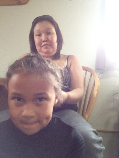 Keira gets a French braid from her mama. August 14, 2012 in kotzebue.