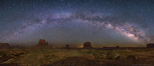 The Milky Way Over Monument Valley Image Credit & Copyright: Wally Pacholka (AstroPics.com, TWAN)  Explanation: You don't have to be at Monument Valley to see the Milky Way arch across the sky like this — but it helps. Only at Monument Valley USA would you see a picturesque foreground that includes these iconic rock peaks called buttes. Buttes are composed of hard rock left behind after water has eroded away the surrounding soft rock. In the above image taken about two months ago, the closest butte on the left and the butte to its right are known as the Mittens, while Merrick Butte can be seen just further to the right. High overhead stretches a band of diffuse light that is the central disk of our spiral Milky Way Galaxy. The band of the Milky Way can be spotted by almost anyone on almost any clear night when far enough from a city and surrounding bright lights.