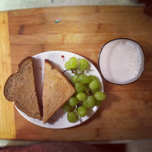Breakfast: pb & j with green grapes and a glass of almond milk.