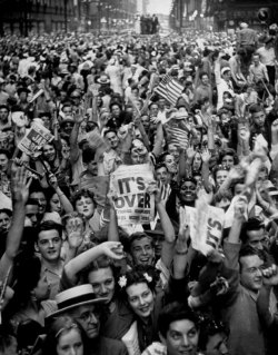 VJ Day, August 14, 1945 - Jubilant crowds scream and flag-wave during celebrations on State Street, Chicago. Gordon Coster