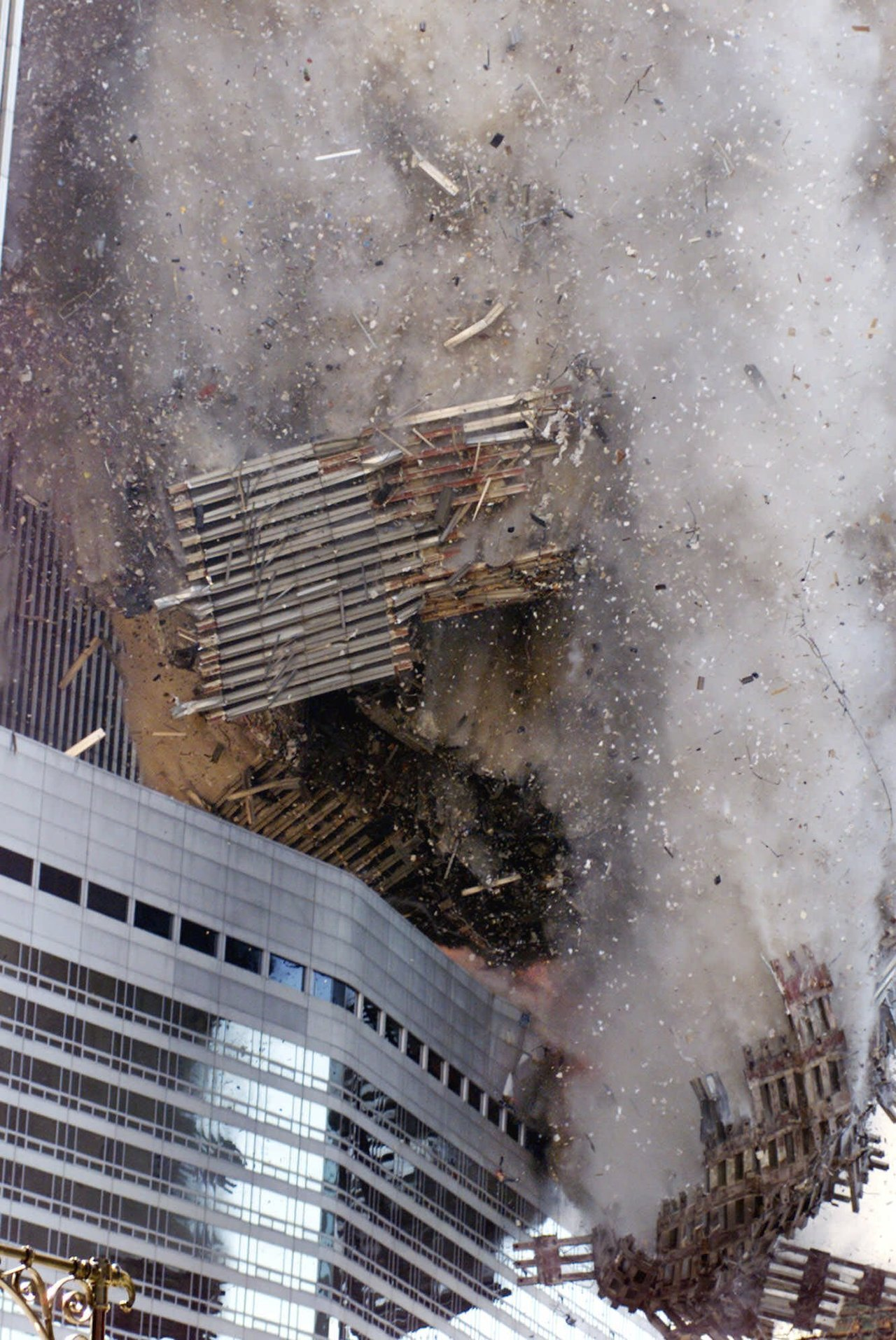 Collapse of the World Trade Center. 3 people can be made out amonst the falling wreckage.