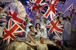 Performers wave the British flag during the Closing Ceremony at the 2012 Summer Olympics, Sunday, Aug. 12, 2012, in London. Photo: Sergei Grits / AP Social media proves a force in consuming Olympics The London Olympics may well be remembered as the event that drove home the power of social media — partly to the chagrin but mostly to the benefit of NBC, which controlled images of the games in the United States. Twitter estimates there were more than 50 million tweets about the Olympics, at a pace of 80,000 per minute after Jamaica's Usain Bolt won the gold medal in the 200-meter sprint. Facebook saw the number of fans of Olympic athletes soar: American gymnast Gabby Douglas had 14,358 followers on July 27 and 540,174 less than two weeks later. All of the activity pumped up interest in the games. NBC executives privately anticipated the London games would have a smaller audience than the Beijing Olympics of 2008. Instead, the network's prime-time audience averaged 31.1 million people a night through Saturday, up 12 percent from Beijing. Many factors surely drove interest, like compelling competition and the amount of coverage available on TV and online. Maybe a recession-weary world wanted a collective, uplifting experience. But the explosion of social media is the one big change in the media landscape that would explain the increased ratings, said Lee Rainie, director of the Pew Research Center's Internet and American Life Project. Facebook had 100 million users four years ago and has 900 million now.