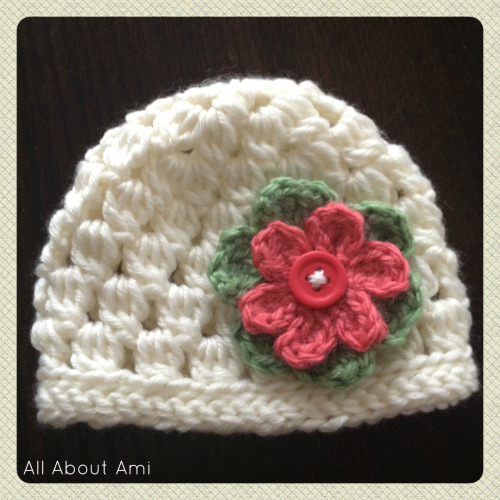 "Here is another baby hat that I really love!  This is the ""Cluster Hat"" by ""Alli Crafts"" made for newborns.  It reminds me of the ""Urban Jungle Slouchy Beanie"" I made last year with the beautiful texture and staggered rows.  Sizing is available for premies, newborns and 6 month olds on her blog for free :)  Isn't this little hat so dainty and pretty?"