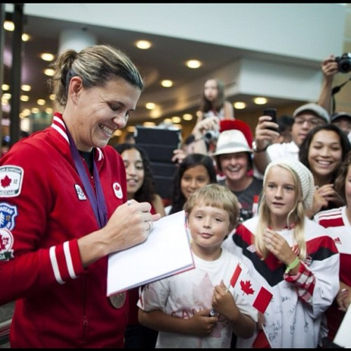Team Canada soccer captain and Olympic bronze medallist, Christine Sinclair, signs autographs for fans after arriving at Vancouver International Airport in Richmond, British Columbia, Monday, August 13, 2012. (Rafal Gerszak for The Globe and Mail) #london2012 #olympics #soccer #photojournalism #canada  (Taken with Instagram)