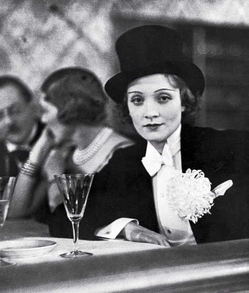 sheisanniebelle:  Marlene Dietrich wearing tuxedo and top hat at ball for foreign press, photo by Alfred Eisenstaedt, Berlin, Germany, 1929