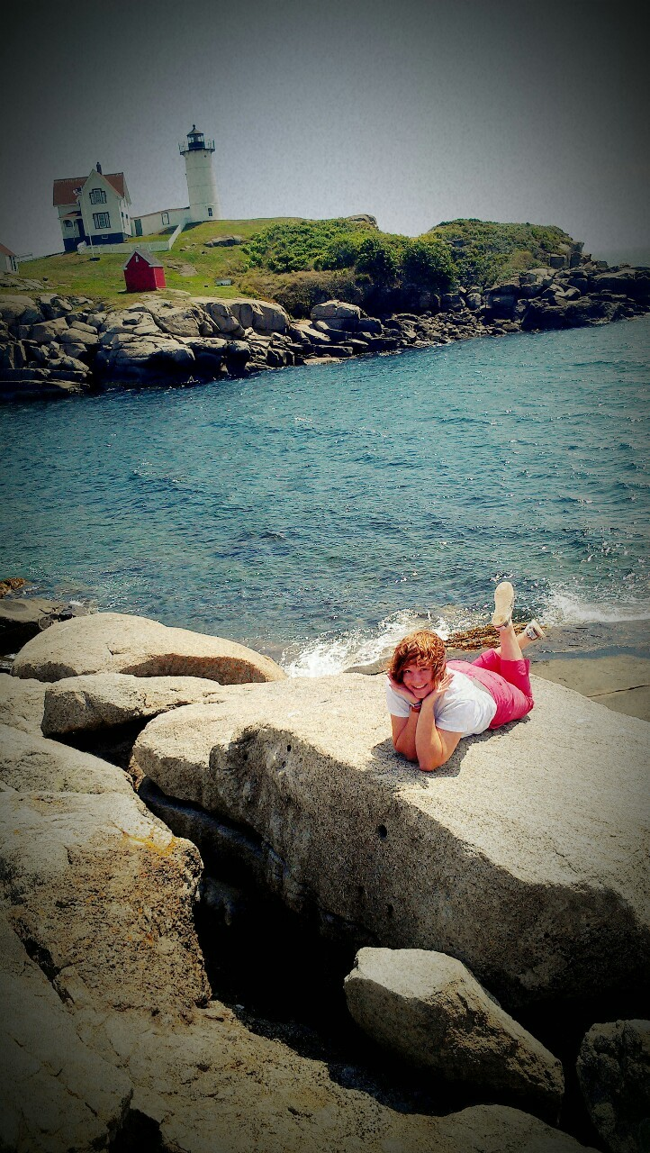 GPOYW: Being adorable on the rocks in front of the lighthouse edition.