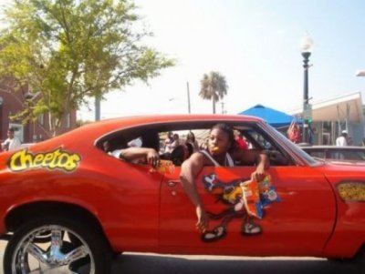 "collegehumor:  Ghetto Cheetos Car Is it considered ridin' dirty if you've got Cheetos dust all over your fingers?  Not really sure what is ""ghetto"" about this car. College Humor might just be run by a fair amount white people, haha. Strangely enough it's not the first Cheetos car I've seen. I'll see if I can dig up a photo!"