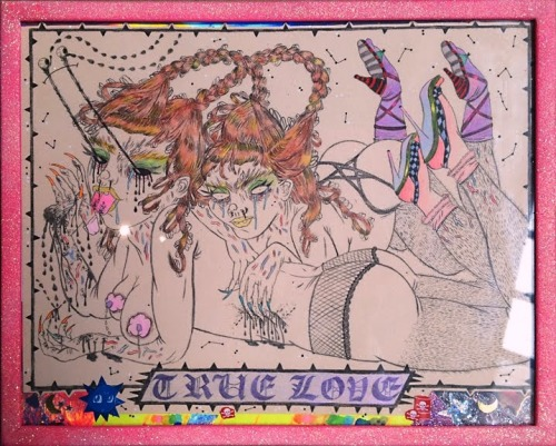 hand colored print of the spread from wet lust in a very sparkly pink frame
