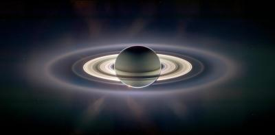 """This is a photo of Saturn as it eclipses the Sun.  If you look closely, You'll see the Sun trying to break thru the eclipse in the bottom left corner.  And to the top left of the main ring system, you'll see a tiny dot.  That dot is Earth.  This photo was taken from the Cassini Spacecraft.  Learn all about it in this wonderful TED talk by Carolyn Porco http://www.youtube.com/watch?v=xxXa9pxwzoY""This photo was just slightly increased colour contrast"