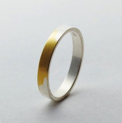 10knotes:  dai-sy-m: the best rings are the ones that mean something. the silver on these rings rub off after time, and reveals the 18 karat gold ring beneath the silver. the point of the ring is to show that the longer love lasts, the more powerful and beautiful it is. Follow this blog, you will love it on your dashboard