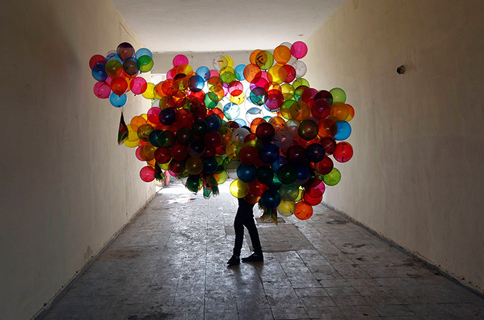 guardian:  Morning Tumblr! Kabul, Aghanistan: a man holds balloons for sale near the National Stadium Photograph: Omar Sobhani/Reuters
