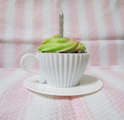 Chocolate Tea-Cup Cakes w/ Lime & Strawberry Bi-Colour Frosting  Happy birthday to me! Today these gorgeous silicon patty cases came in the mail, a present from one of my friends from school. They are too cute! And of course I had to use them right away. This was also the first time I've tried piping bi-coloured frosting, and I'm quite pleased with the result - not only, bi-coloured, but with two different flavours too.