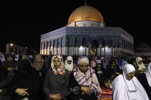 theyoungwillneverforget:   Muslim women pray during Laylat al-Qadr in front of the Dome of the Rock, on the compound known to Muslims as al-Haram al-Sharif (Noble Sanctuary) and to Jews as Temple Mount, in Jerusalem's Old City during the holy month of Ramadan late August 14, 2012. Reuters Pictures  It's so beautiful to see so many Palestinians praying in one of the most holy religious sights.  It's a shame that so many others will never get this opportunity because of the occupation and the Israeli Apartheid Wall which confines them to the West Bank, prohibiting them from leaving without a permit.