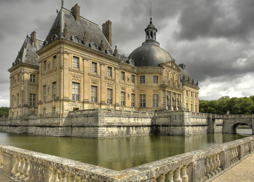 "Vaux le Vicomte @credits  The Château de Vaux-le-Vicomte is a baroque French château located in Maincy, near Melun, 55 km southeast of Paris in the Seine-et-Marne département of France. It was built from 1658 to 1661 for Nicolas Fouquet, Marquis de Belle Île, Viscount of Melun and Vaux, the superintendent of finances of Louis XIV. The château was an influential work of architecture in mid-17th century Europe. At Vaux-le-Vicomte, the architect Louis Le Vau, the landscape architect André le Nôtre, and the painter-decorator Charles Le Brun worked together on a large-scale project for the first time. Their collaboration marked the beginning of the ""Louis XIV style"" combining architecture, interior design and landscape design. The garden's pronounced visual axis is an example of this style."