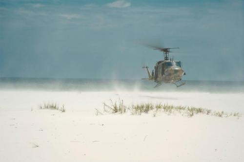 A U.S. Air Force UH-1N Huey Gunship lands on the beach in Navarre Florida on Aug. 13. The 6TH Special Operations Squadron flies the Huey in support of their mission of combat aviation advisory.