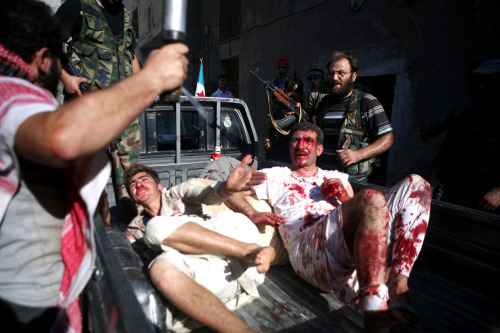 "politics-war:  Rebel Free Syrian Army (FSA) fighters capture two policemen who the FSA allege are ""Shabiha"" or pro-regime militiamen, as the rebels overran a police station in Aleppo. A watchdog said that rebels killed 40 officers and seized three police stations during the pivotal battle for the commercial capital."