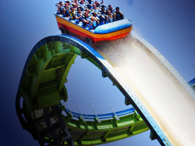 "Knotts Berry Farm - Perlious Plunge TO CLOSE!  Knott's Berry Farm has revealed that it will close its Perilous Plunge water ride on September 3, 2012, sparking rumors that a new attraction will replace it. The park confirmed the closure date via its official Facebook page, promising that ""future plans for the site will be released soon"". The nature of Perilous Plunge's replacement is unknown at present, although there have been consistent rumors that an enormous new roller coaster designed by Bolliger & Mabillard will be installed at the park. Themed around the seaside funfairs of years gone by, Perilous Plunge is a classic ""shoot-the-chutes""-style ride. It sees guest being carried in large boats to the top of a 121-foot tower, before plummeting down a 115-foot, 75-degree drop into a splash zone below. Its height made it the tallest water ride in the world when it debuted in September 2000. Perilous Plunge underwent significant changes after a fatal accident in 2001 which saw a rider killed after falling out of a boat during the descent. This resulted in new, smaller boats being installed, reducing the size of the splash at the bottom, but enabling essential updates to the safety restraint system."